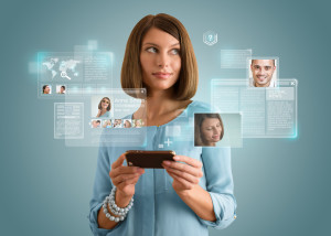Pretty modern woman using her smartphone and virtual interface